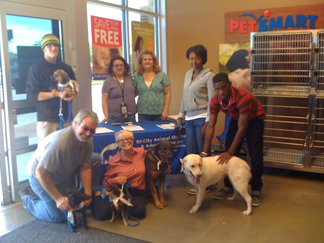 Photo of volunteers with animals at the local Petsmart