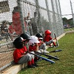 Young children waiting for their turn at bat